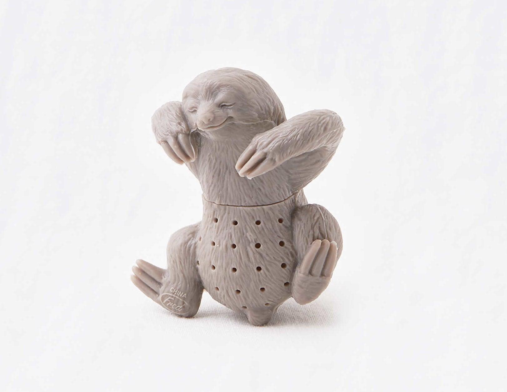 A gray sloth shaped tea infuser