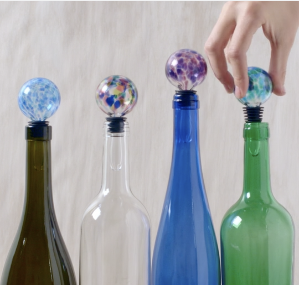 Four handblown wine stoppers in different colors