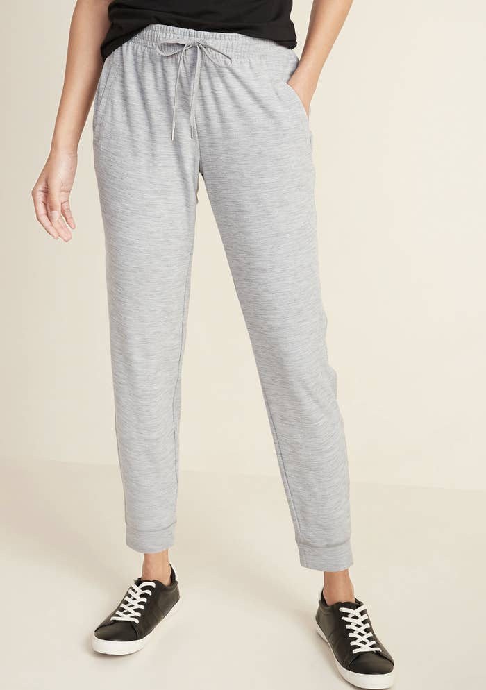 a reviewer in gray heathered joggers