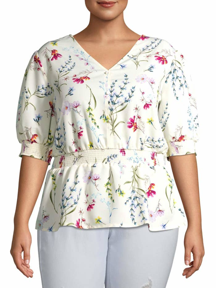 The cinched white floral top with puff sleeves