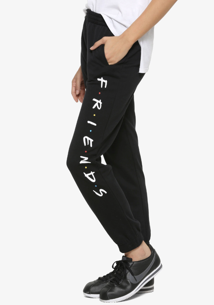 black sweatpants with the friends logo down the side