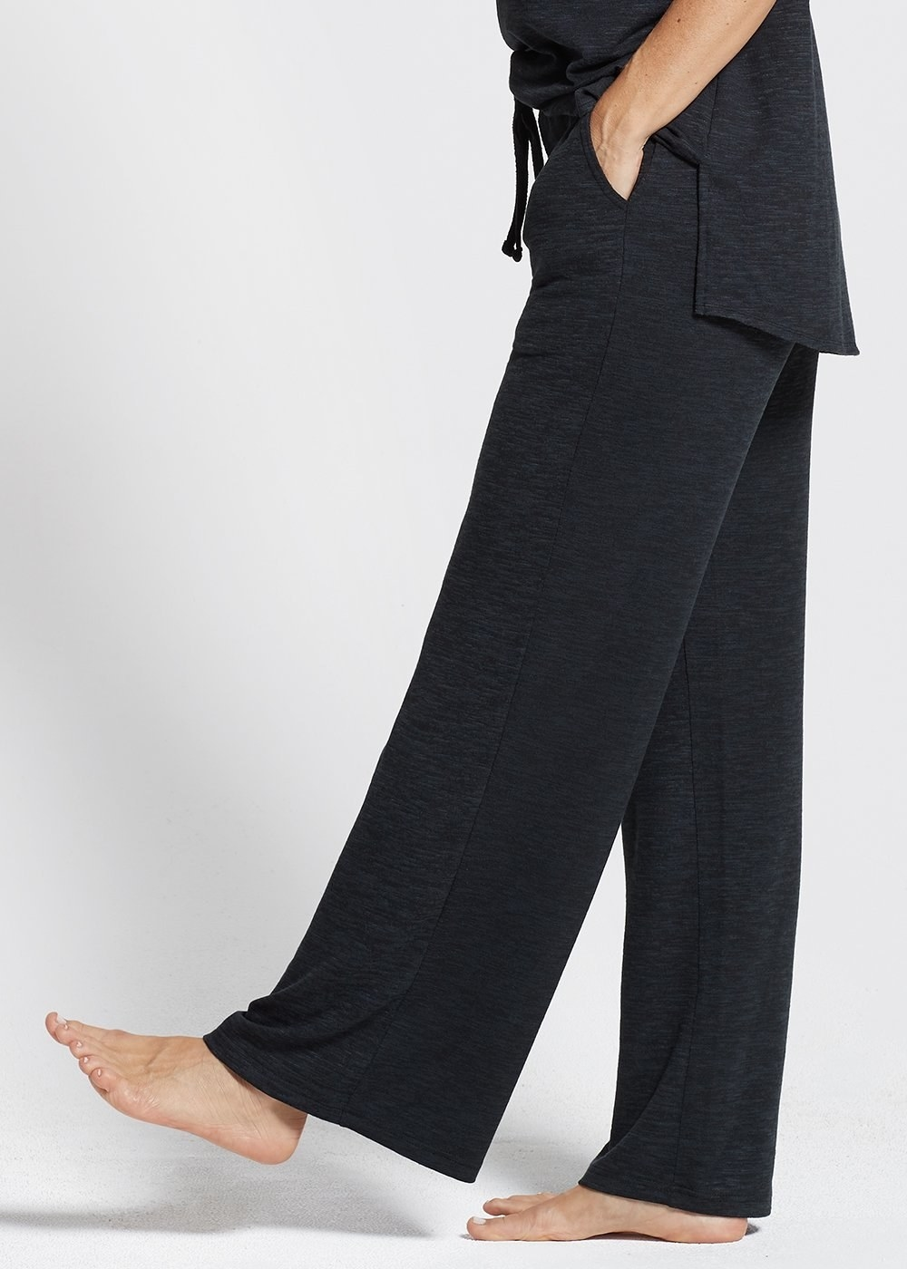 A model wearing the pants in Black Marl