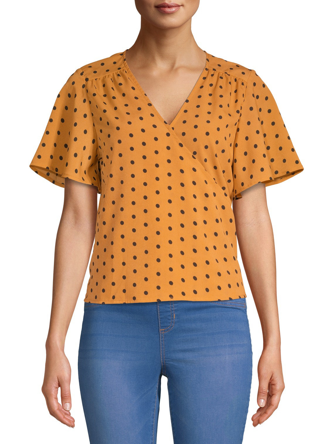 The black and yellow polk dot top