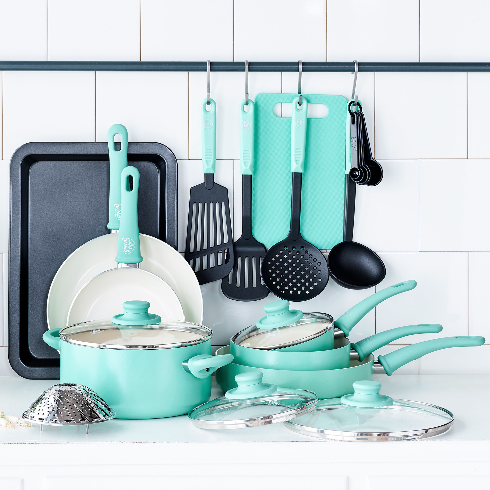 pots, pans, and cooking utensils in a light turquoise color