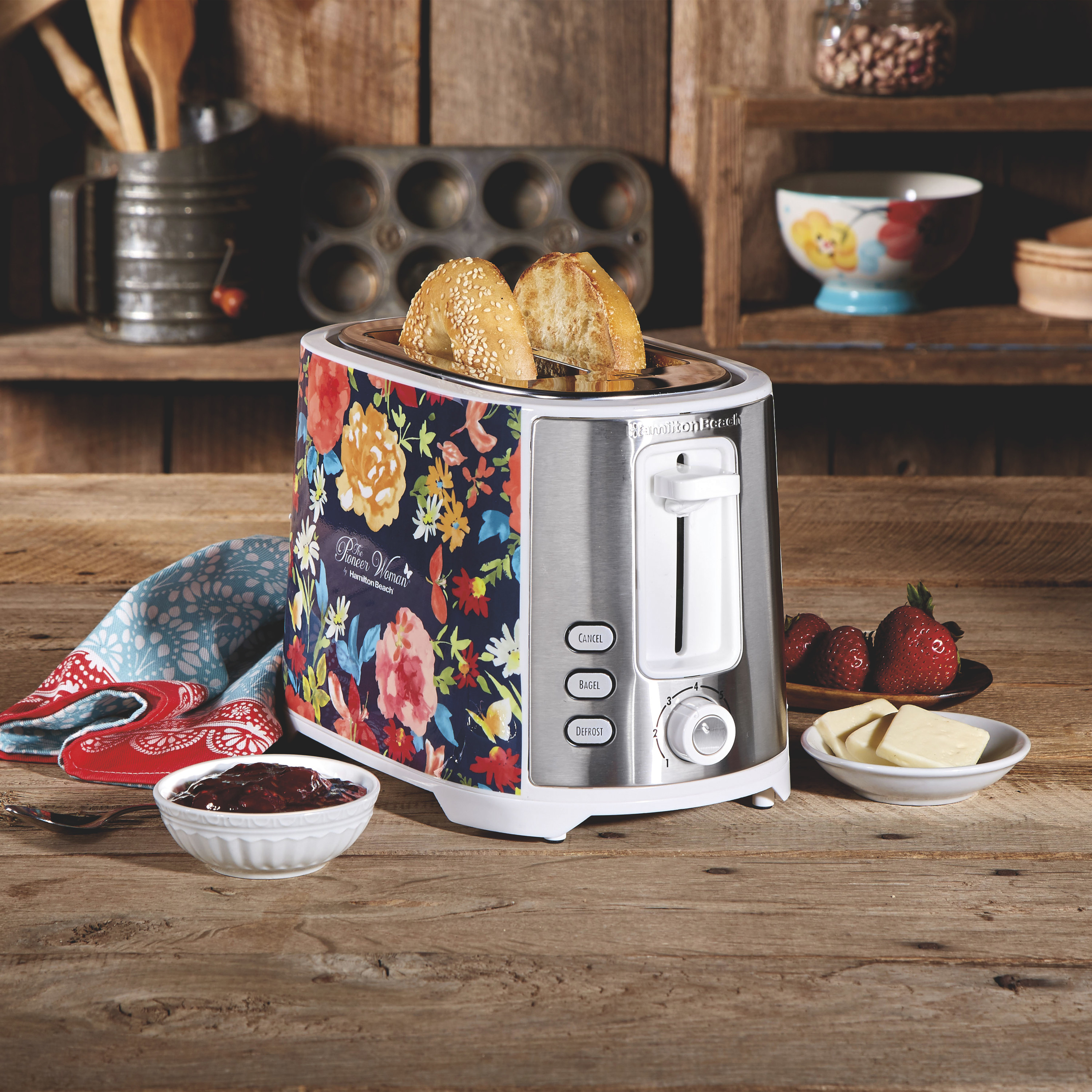 a top loaded toaster with a floral pattern on it