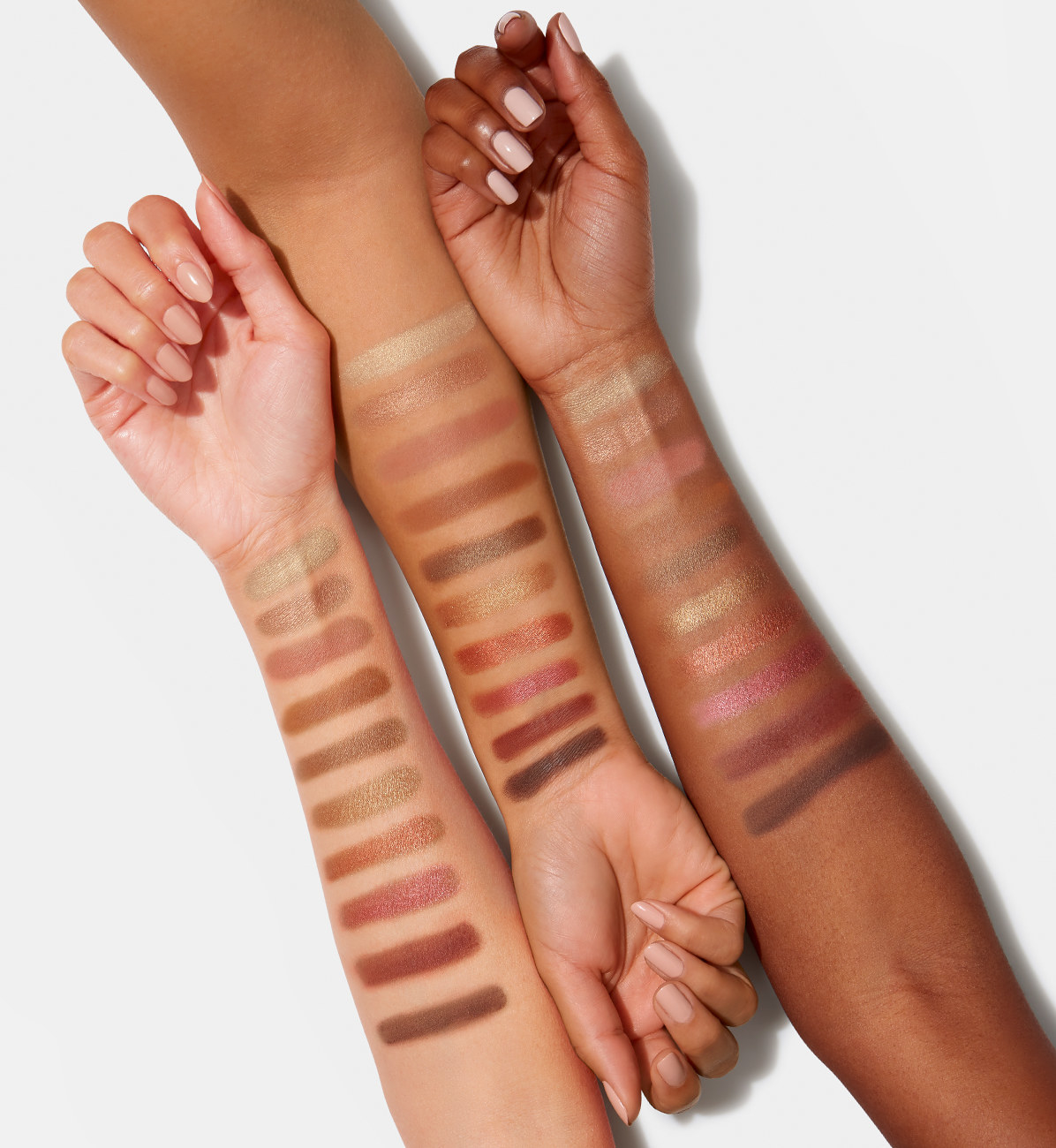 Three models' arms with the eyeshadow shades to show its shade range