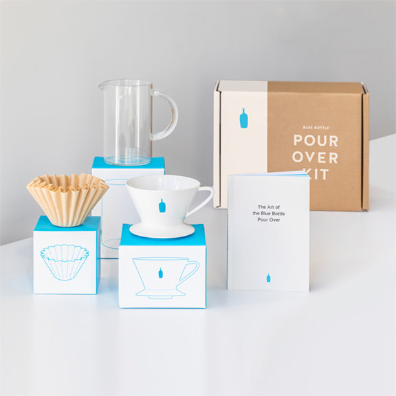 The coffee kit with a cup, filters, a bottle, and instructions