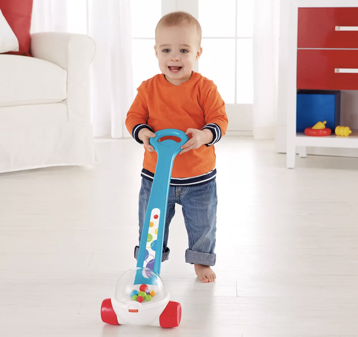a toddler pushing the toy