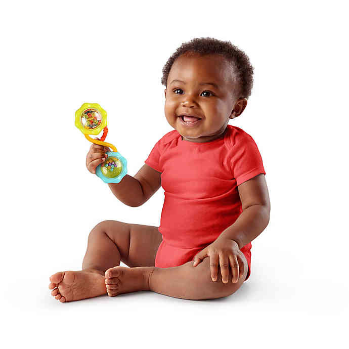 a baby holding the barbel-shaped rattle in his hand