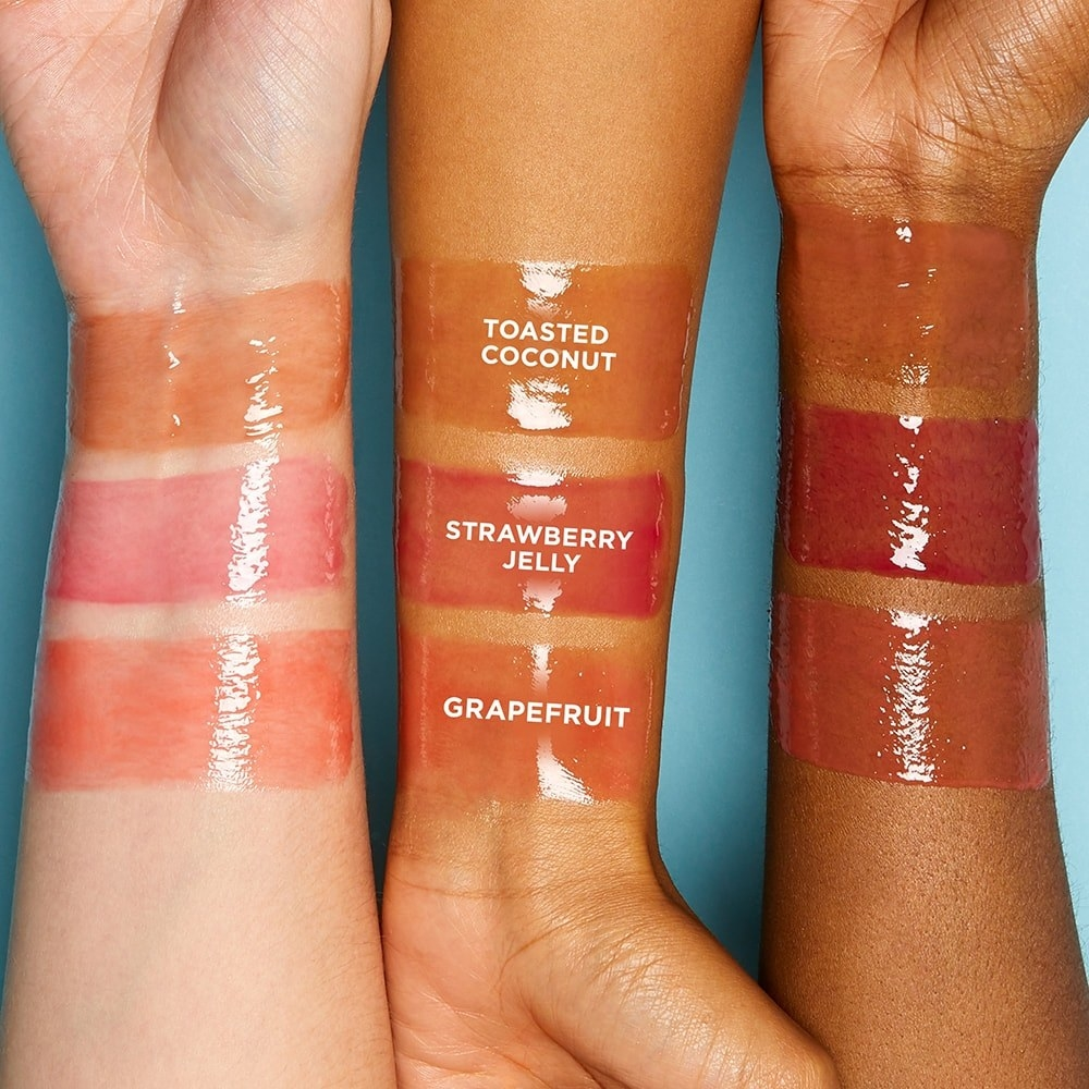three models with glossy fruity colors swatched on their forearms