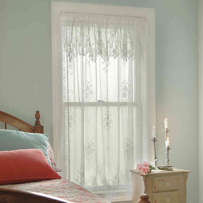 sheer white lace curtains on a small window