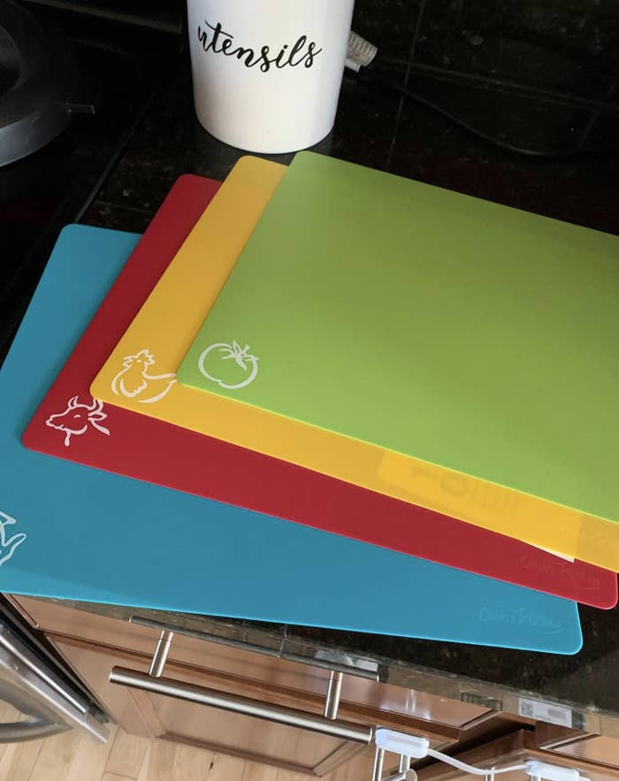 Four color-coded mats no bigger than the traditional folder size that are green, yellow, red, and blue