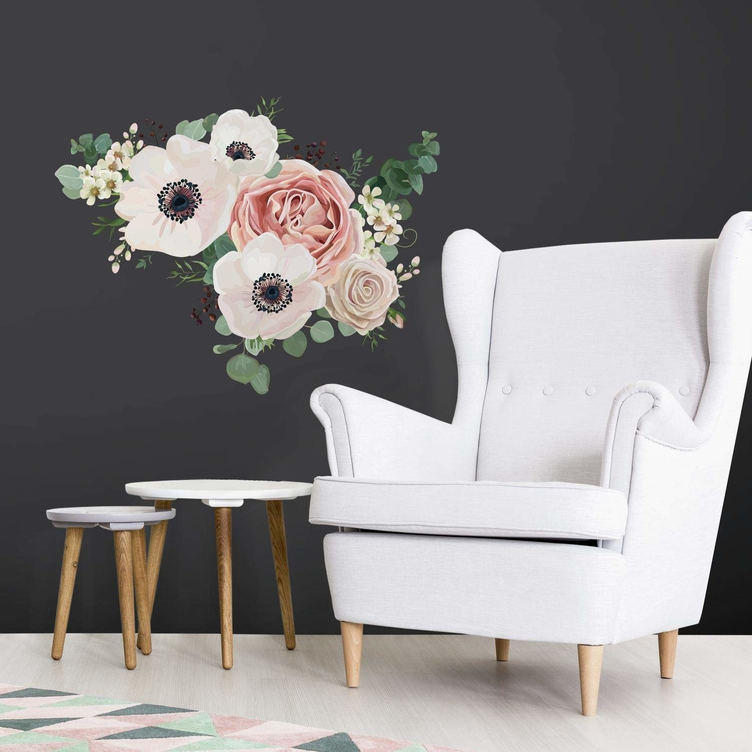 A wall decal shaped like a pink and ivory cluster of flowers stuck to a wall