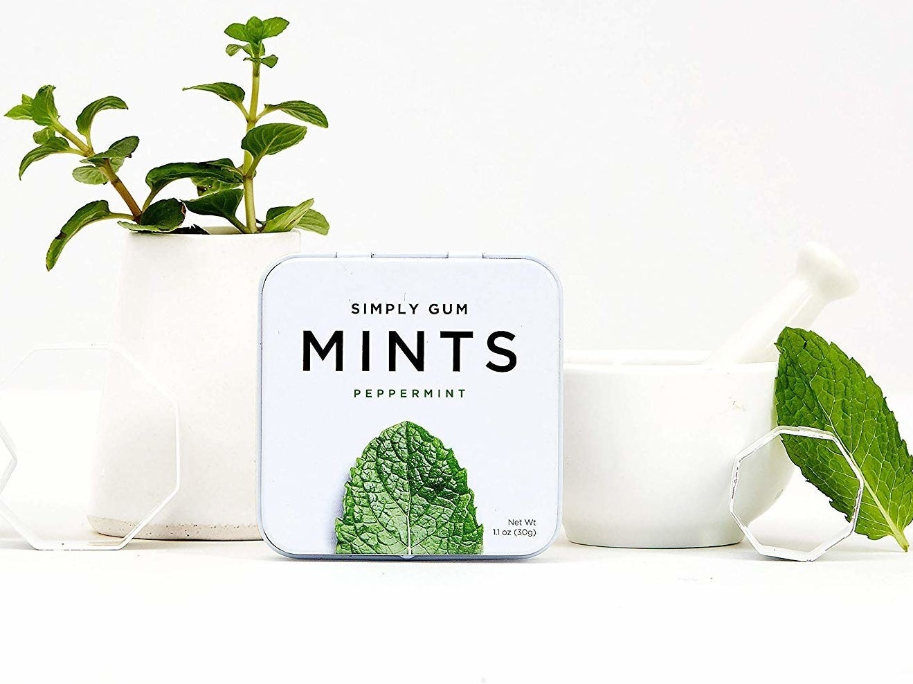 A small tin of breath mints on a counter