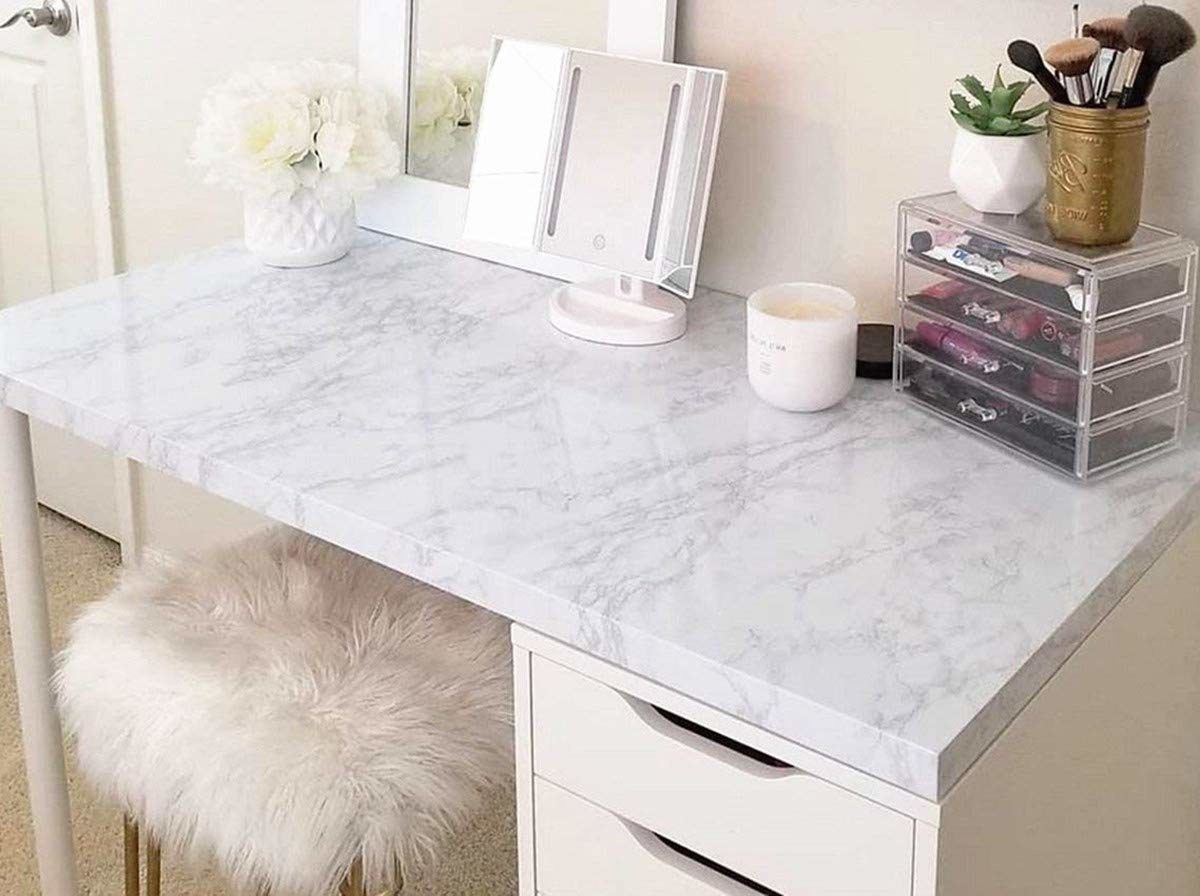 Faux white and granite covering a white desk