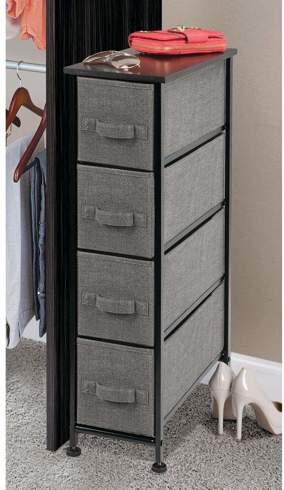 four-drawer dresser with grey drawers and black frame