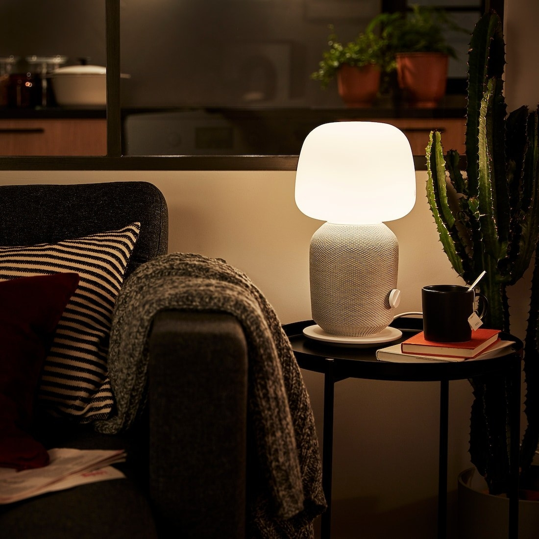 the grey speaker light sitting on a side table