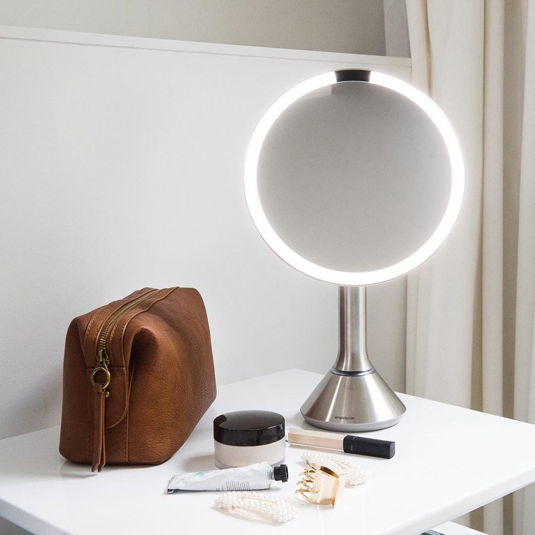 mirror lit up and styled on a vanity