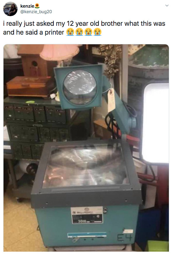 tweet reading i really just asked my 12 year old brother what this was and he said printer with a picture of an overhead projector