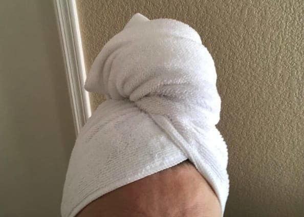 reviewer wearing the microfiber towel