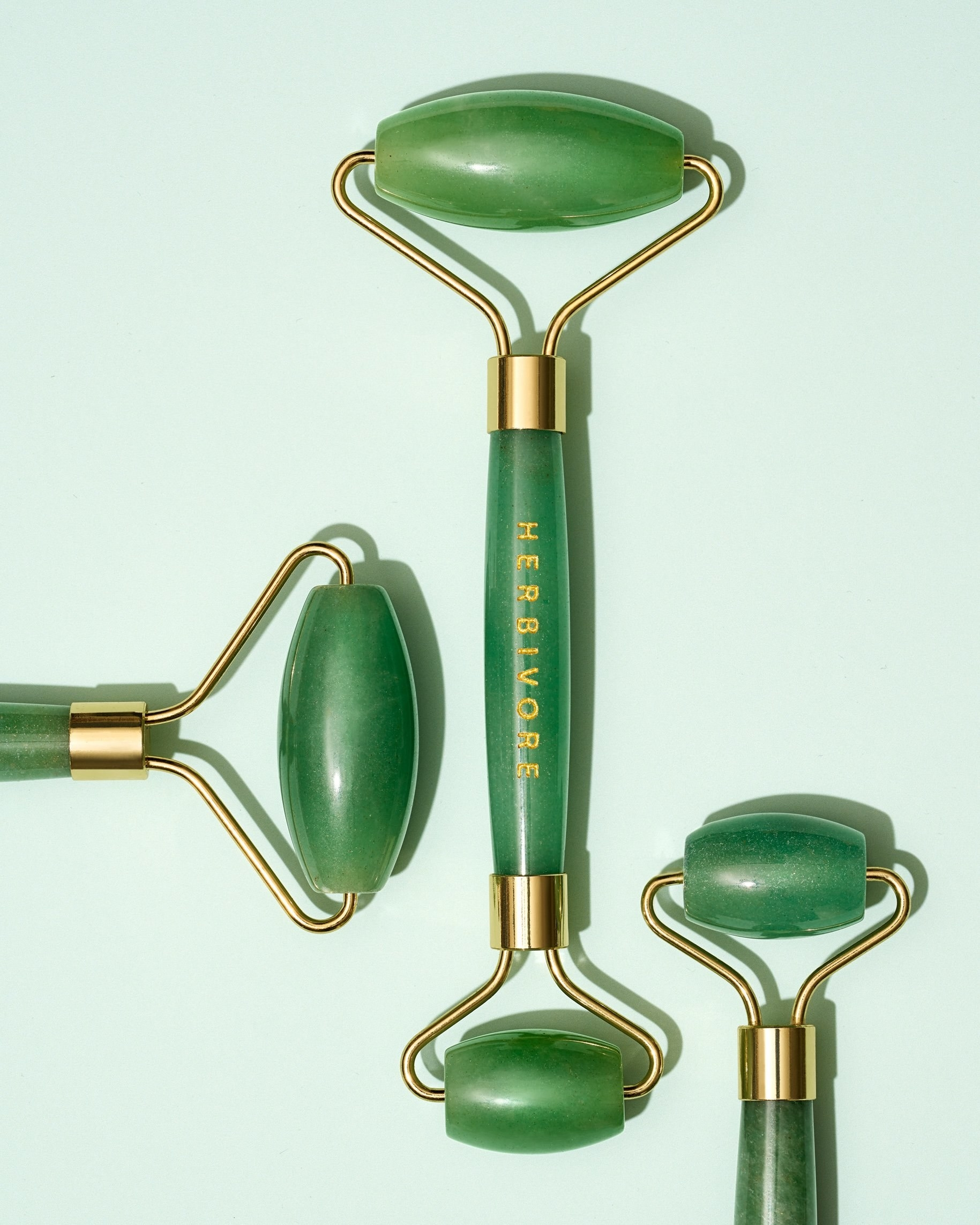 Three jade rollers in a group