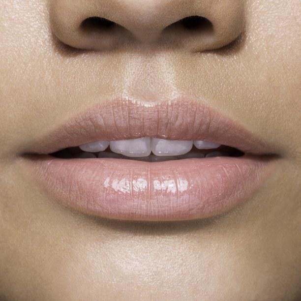 Model wearing the light pink lip gloss