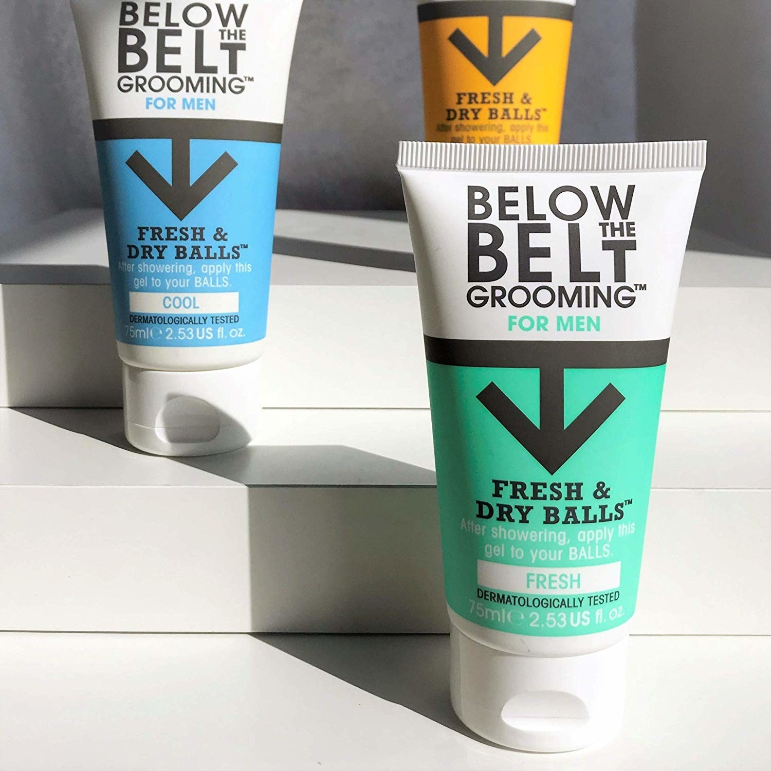 Three tubes of Below the Belt cream in various scents