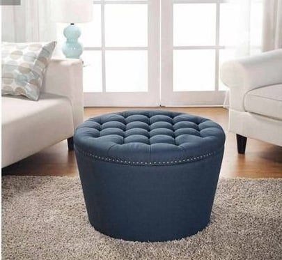 A tufted ottoman with room for storage