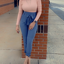 Reviewer styles same trousers in blue with a light pink long-sleeve blouse