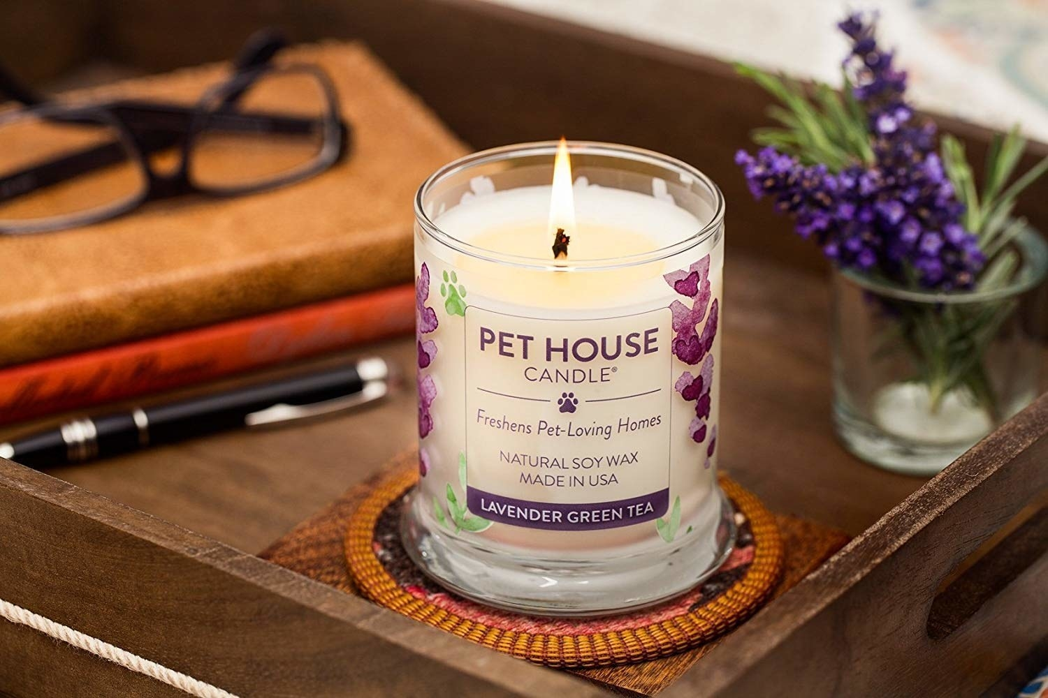 lavender green tea candle sitting on coffee table