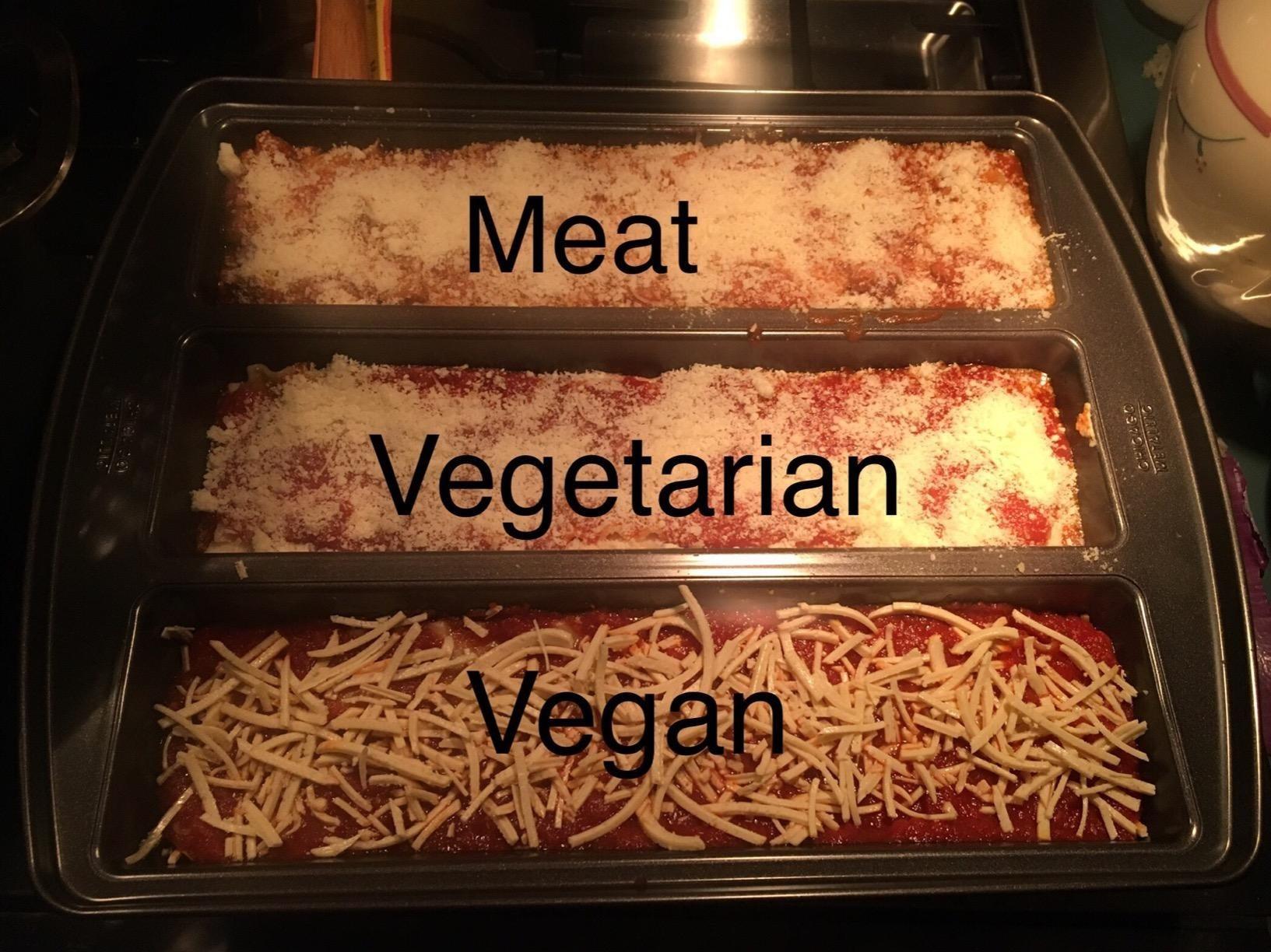 Reviewer photo of the lasagna pan, which has three slots for a meat lasagna, a vegetarian lasagna, and a vegan lasagna
