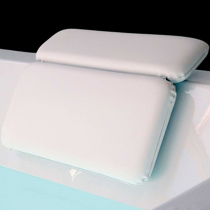 The pillow with two rectangular parts suctioned to the lid of a tub