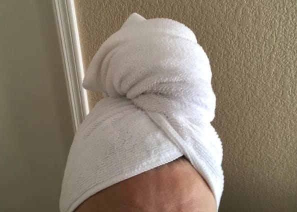 reviewer image of the white towel wrapped on top of their head, drying their hair