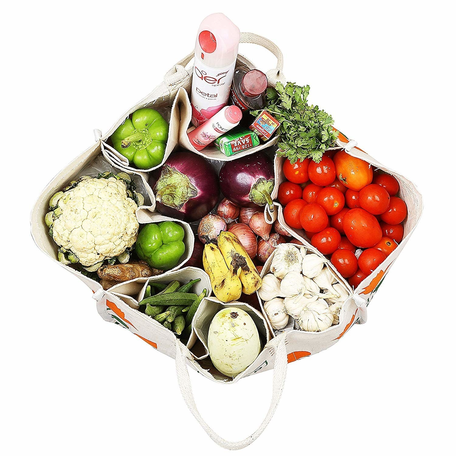 A canvas grocery bags sectioned off with vegetables in it
