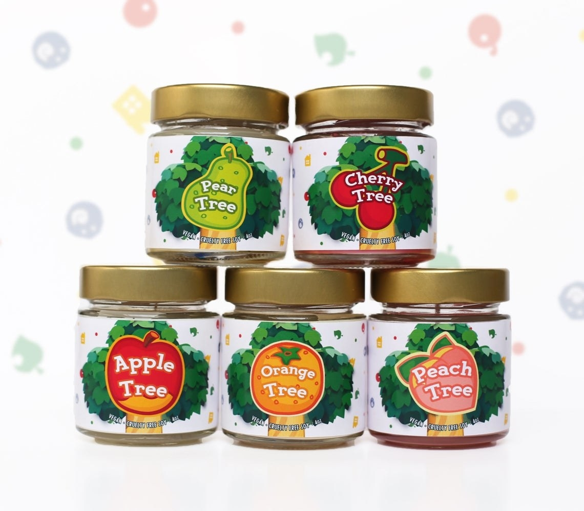 stack of candles with animal crossing fruit designs