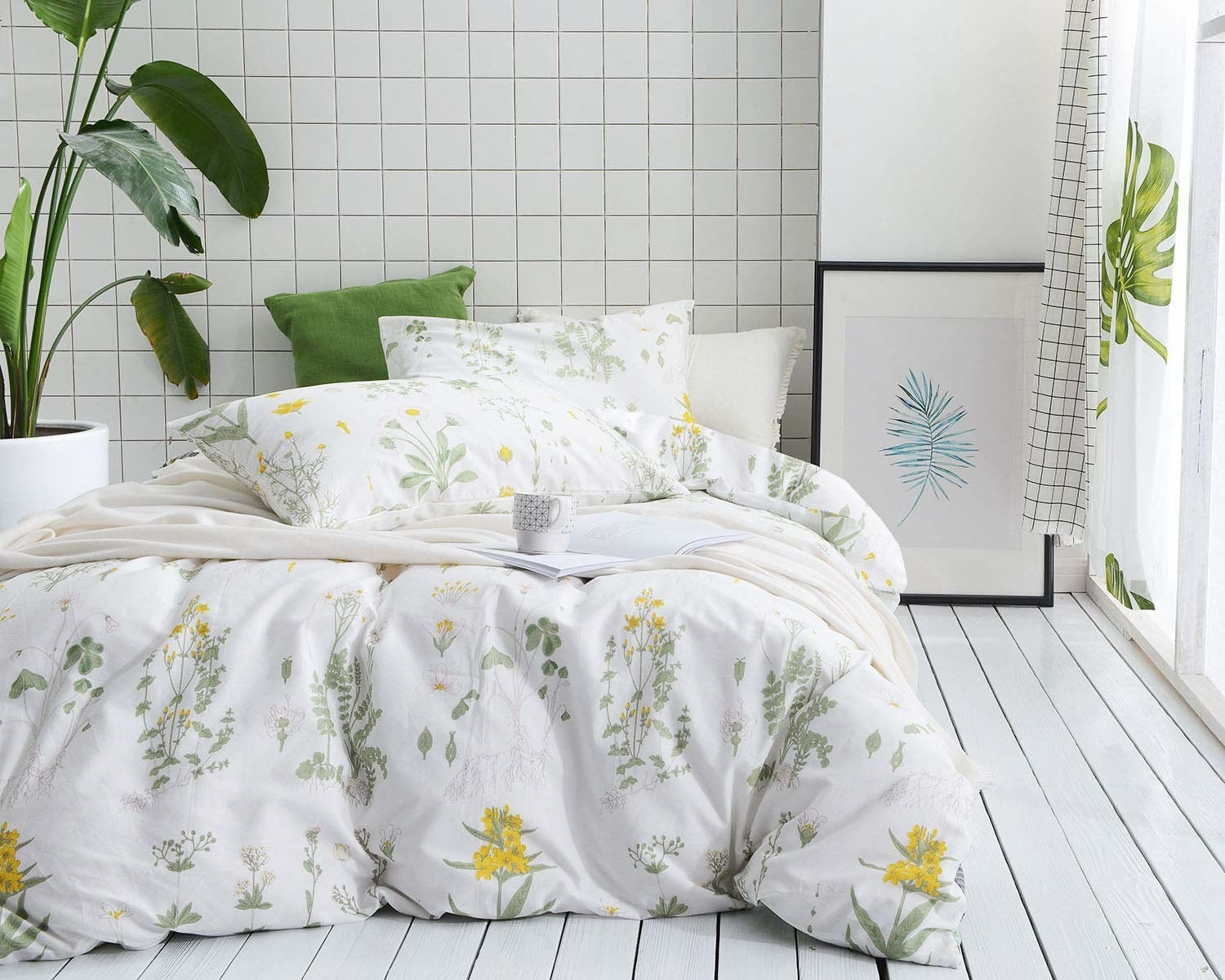 White bedding with green and yellow vintage floral print