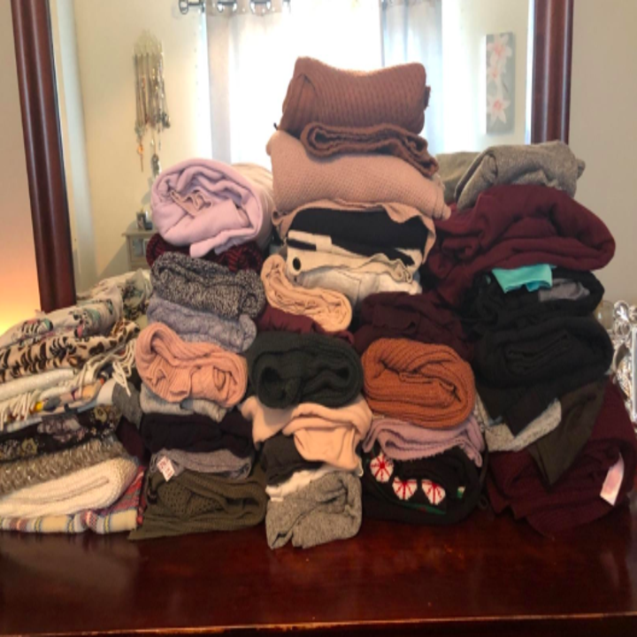 a reviewer's large stack of clothes