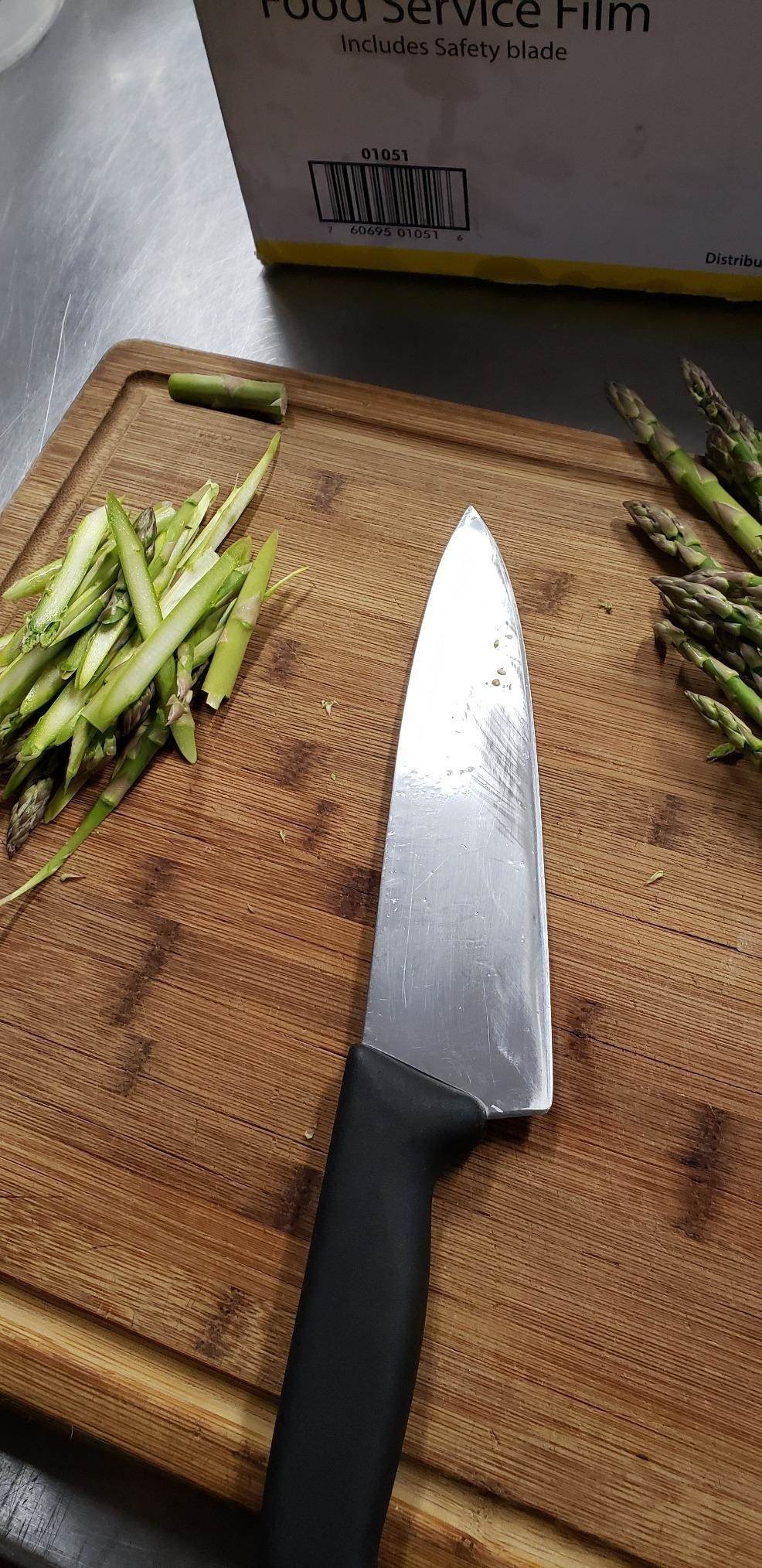 a reviewer's photo of the chef knife on a wooden cutting board