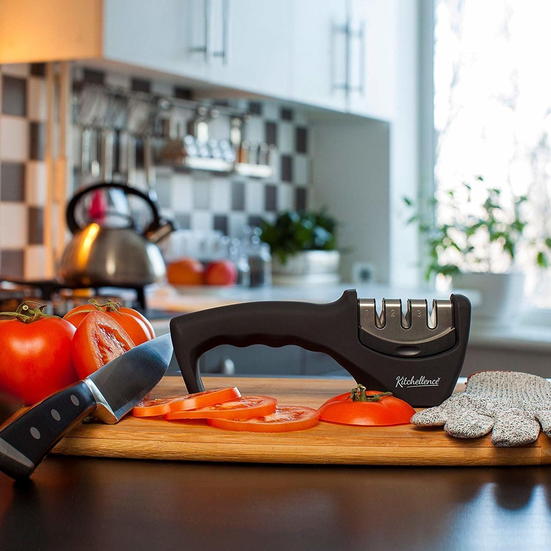 the knife sharpener on a cutting board