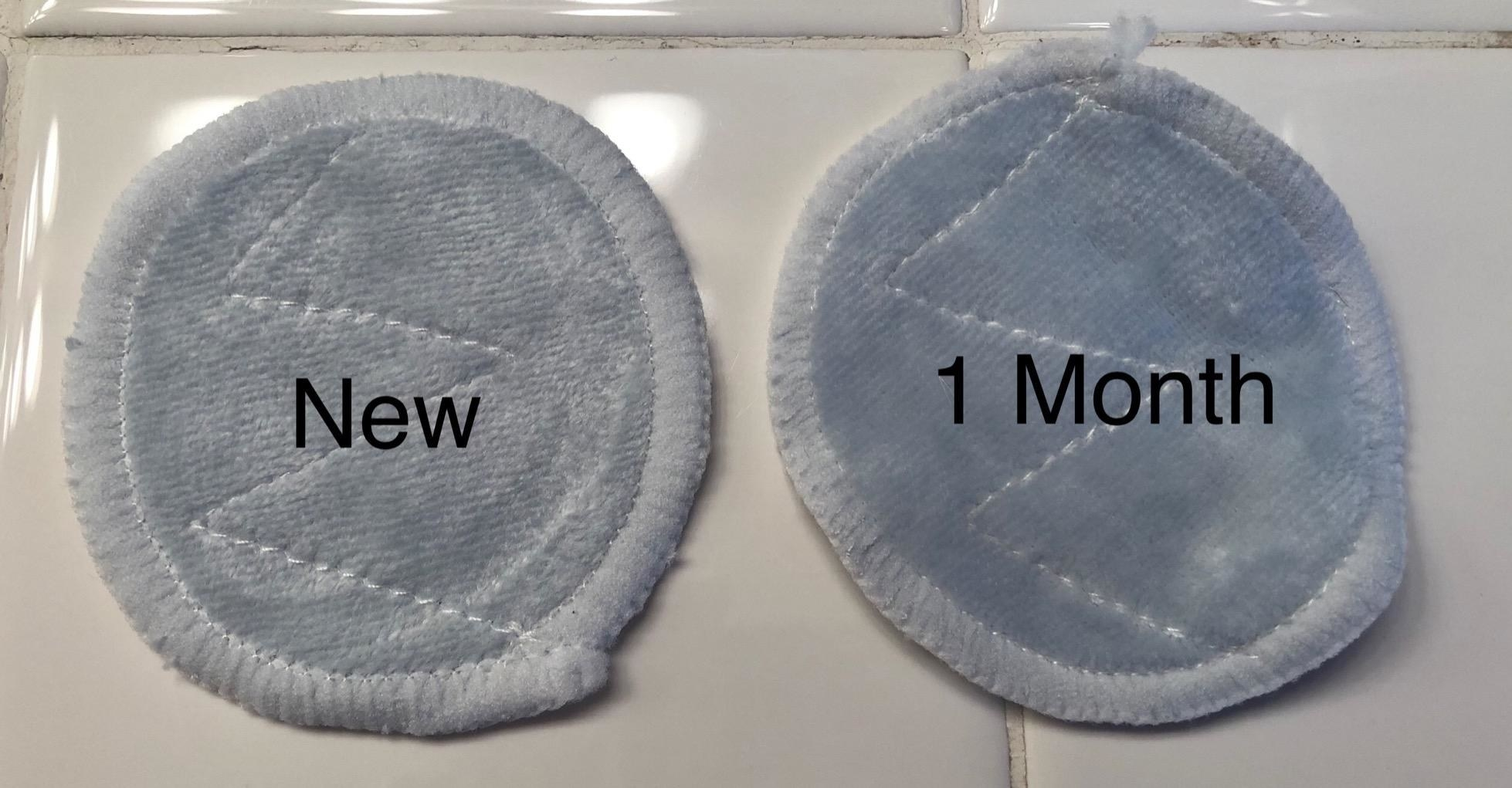 the cleansing cloth as it is new, and a second one beside it showing that it still looks smooth and useable even after one month's use