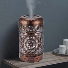 the essential oil diffuser on a table top