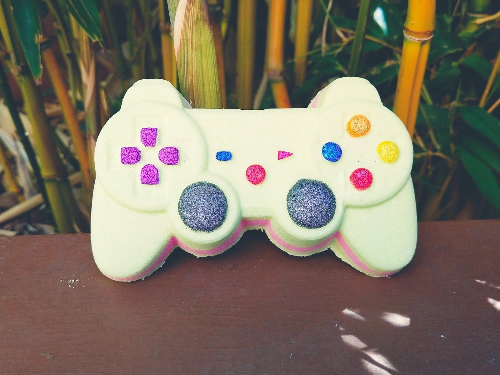 a bath bomb shaped like a playstation controller