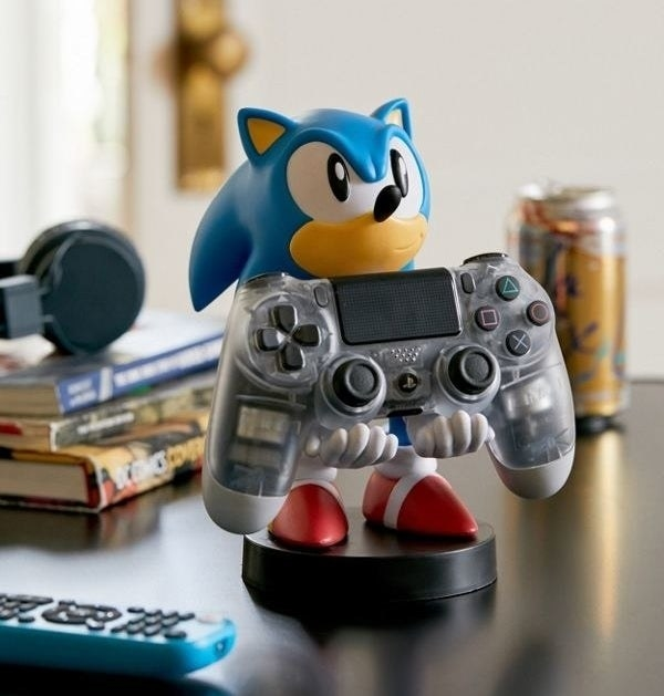 sonic the hedgehog holding a video game controller