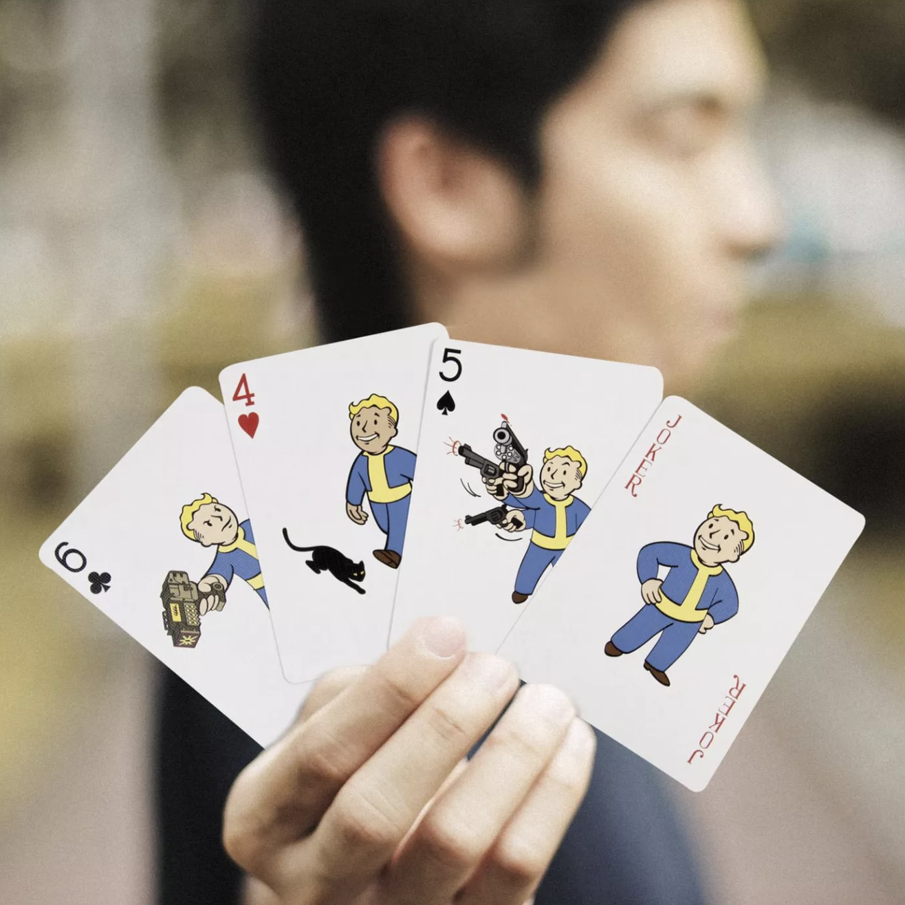 a model holding up four of the cards