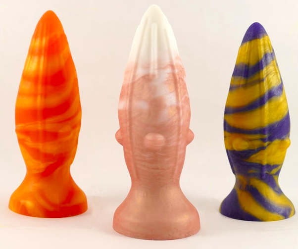 three of the rhombus toys, two with textured bumps on the side