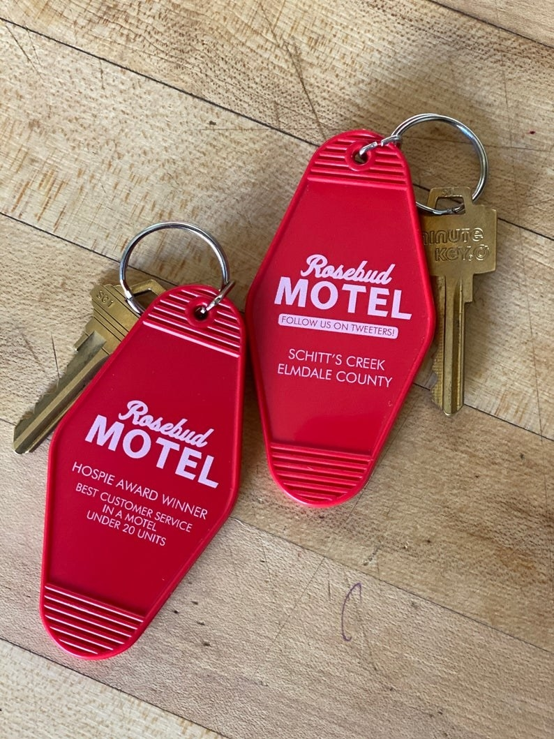 "two keychains that say ""Rosebud motel"""
