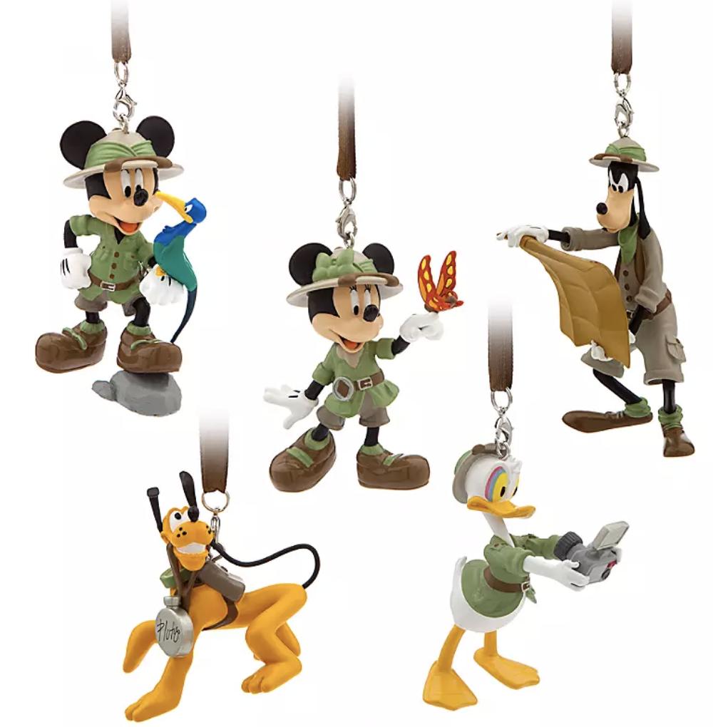ornaments of mickey, minnie, donald, goofy, and pluto in safari gear