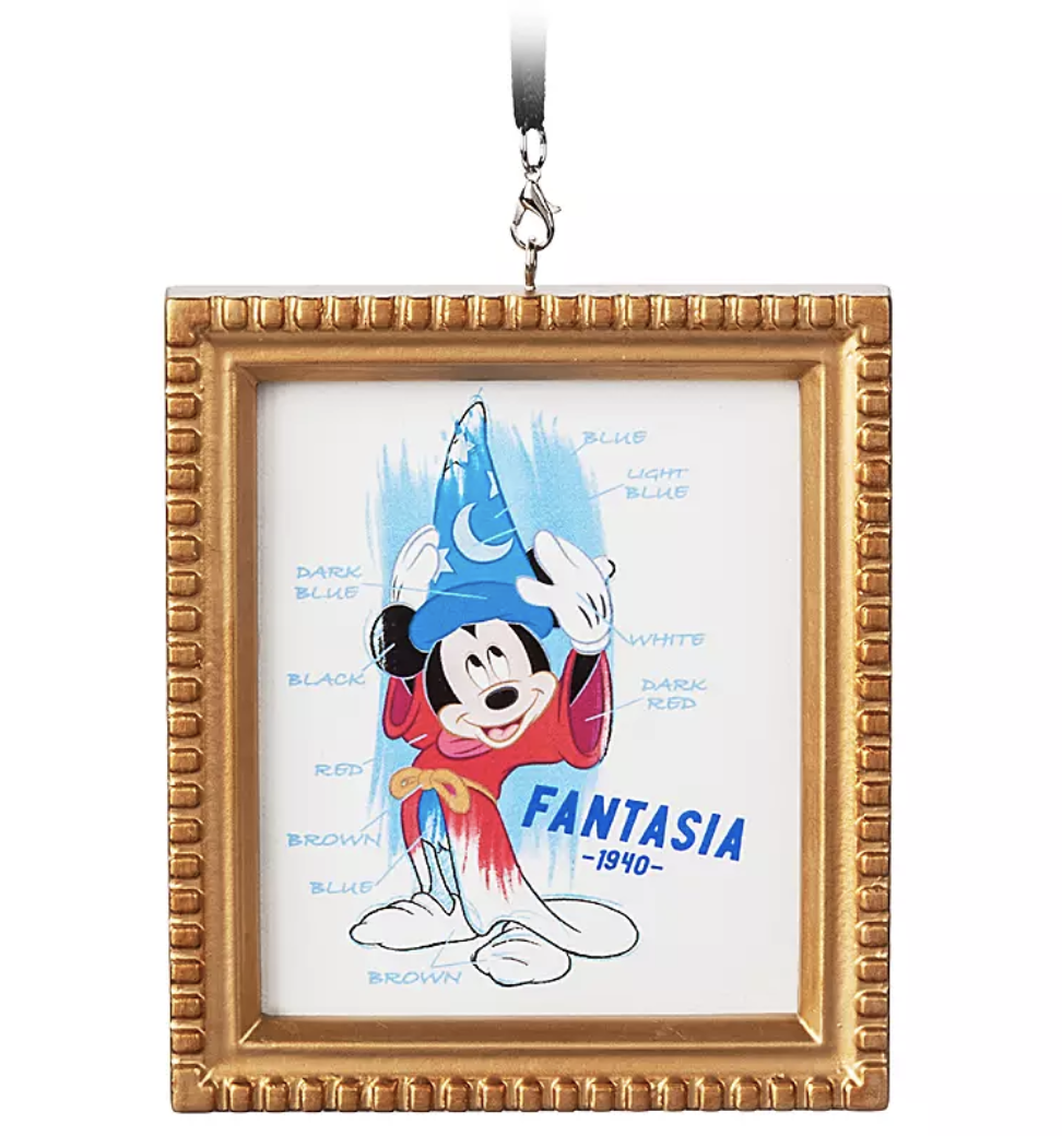 an ornament designed to look like a gold frame with an illustration of sorcerer mickey inside