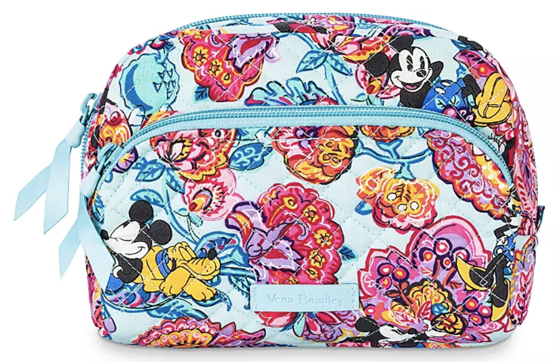 a quilted makeup bag with two zippered pockets and floral design with mickey and pluto woven throughout it
