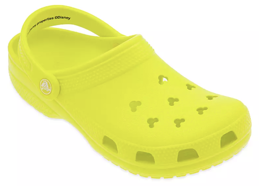 neon yellow crocks with mickey shaped cut-outs on the top